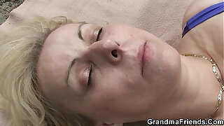Brazzers xxx: Blonde old women swallows two cocks outdoor